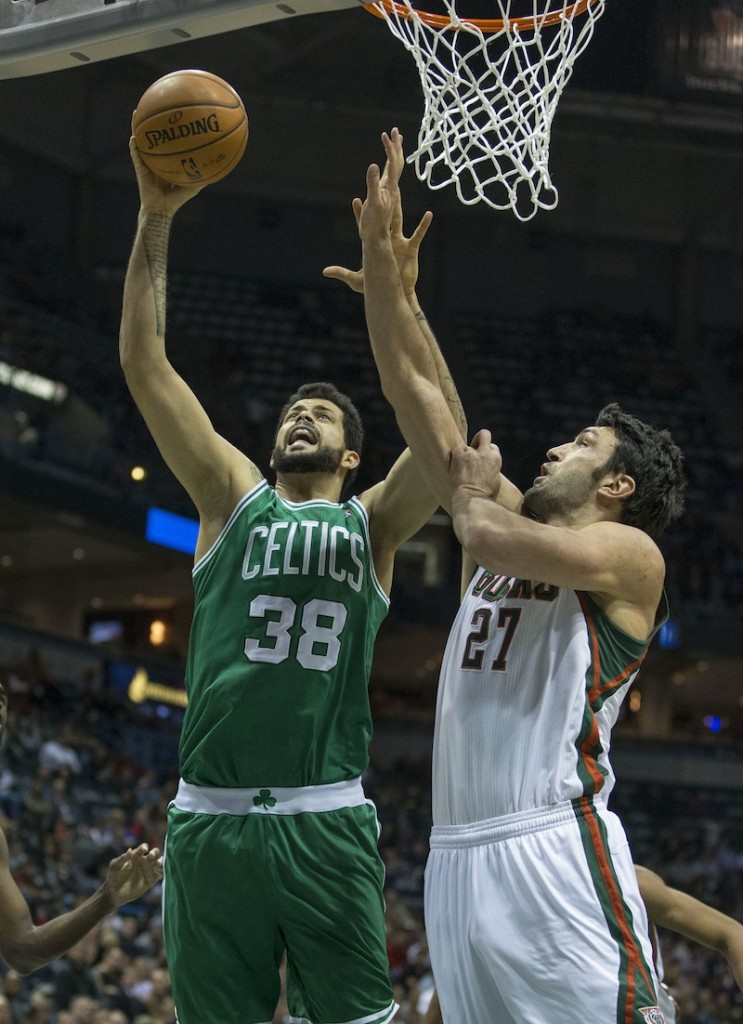 In this November 2013 file photo, Boston Celtics' center Vitor Faverani scores during the first half of an NBA basketball game. Faverani will join the Maine Red Claws the Celtics announced on Jan. 31, 2014.