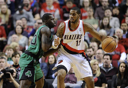 Celtics forward Brandon Bass defends against the Trail Blazers center LaMarcus Aldridge in the first half of their game Saturday in Portland, Ore.