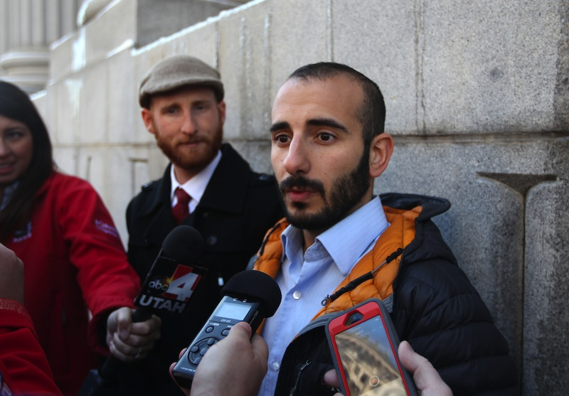 Derek Kitchen, left, and his partner Moudi Sbeity, right, talk with the media outside Frank E. Moss U.S. Courthouse following court on Dec. 4, 2013, in Salt Lake City. Since hundreds of same-sex couples already have married in Utah, there is no urgent need for the Supreme Court to intervene now in the legal battle, lawyers for gay couples told the justices Friday.