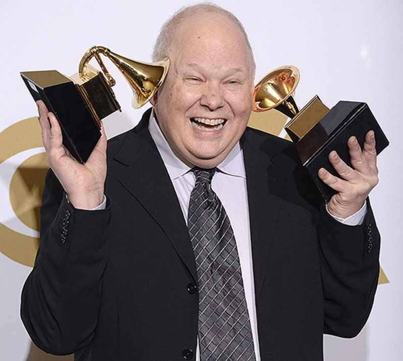 Bob Ludwig holds up his Grammys for best historical album for