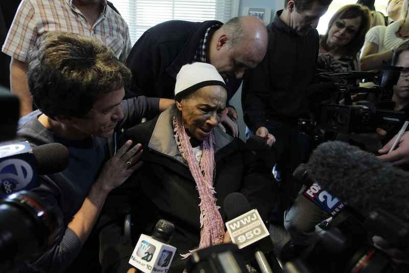 In this April 4, 2012 file photo, Texana Hollis thanks volunteers for fixing her home in Detroit. Hollis, who got her home back in 2012, at the age of 101, after being evicted because of foreclosure, has died. She was 103.
