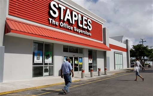 The opening of Postal Service retail centers in dozens of Staples stores around the country – like this one in Miami – is being met with threats of protests and boycotts by the agency's unions.