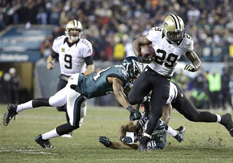 New Orleans Saints' Khiry Robinson runs during the second half of an NFL wild-card playoff game against the Philadelphia Eagles on Saturday in Philadelphia.