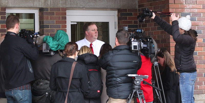 Salt Lake City School District spokesman Jason Olsen speaks to reporters Thursday at Uintah Elementary School in Salt Lake City. A school district apologized after about 30 students had their lunches thrown out because of outstanding balances on their food accounts.