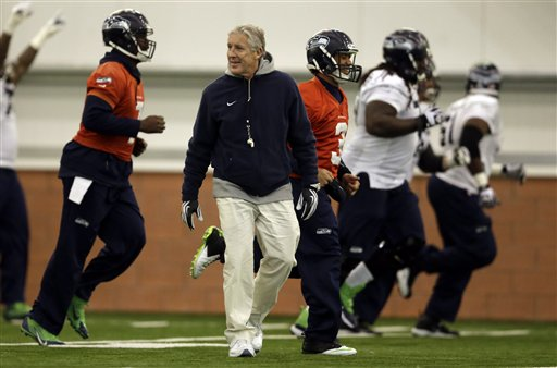 Seattle Seahawks head coach Pete Carroll watches members of his team warm up during practice Thursday in East Rutherford, N.J. The Seahawks and the Denver Broncos are scheduled to play in the Super Bowl XLVIII on Sunday.