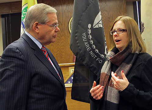 U.S. Sen Robert Menendez listens to Peggy Molloy, who fears that skyrocketing flood insurance premiums will force her from her Point Pleasant, N.J., home, Thursday. The two spoke at a Jan. 2 public hearing on a bill by the Democratic senator to delay flood insurance rate hikes by up to two years while the federal government studies their affordability.