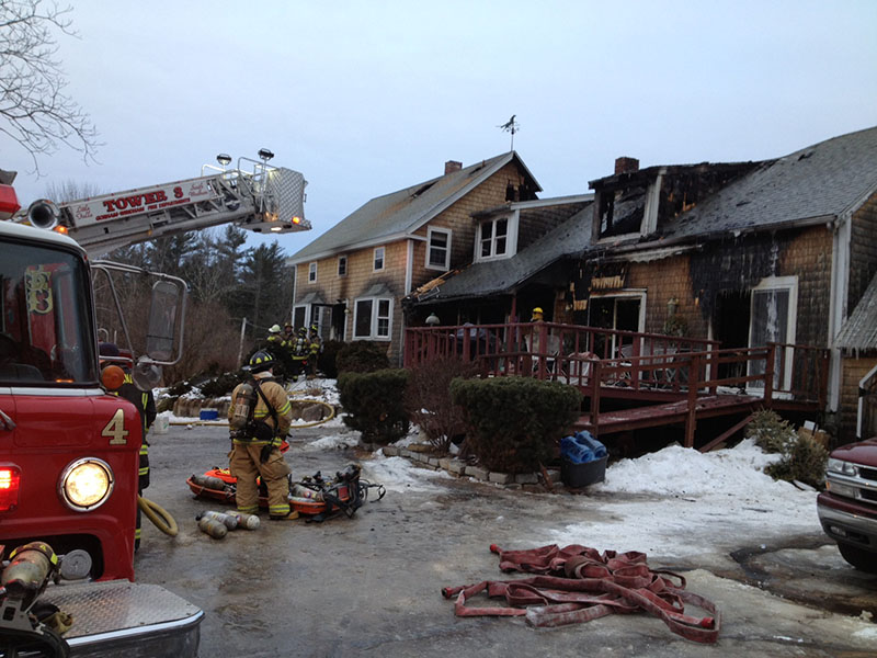 Scene of a Finley Road fire in Windham. Firefighters were recalled the the home Wednesday morning when the fire, which was thought to be extinguished, rekindled.