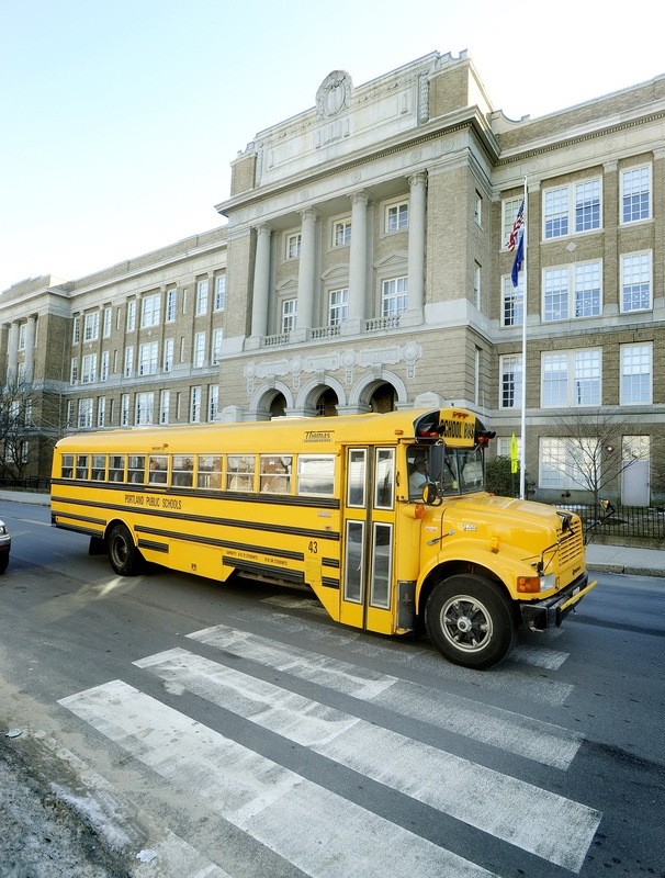 A school bus passes by Portland High School.