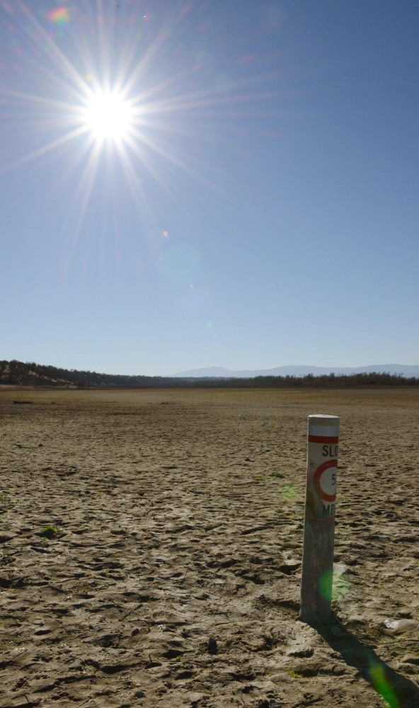 Evidence of California's crippling drought, a boat speed-limit buoy rises out of the dry bed of Black Butte Lake near Orland Buttes Recreation Area last month.