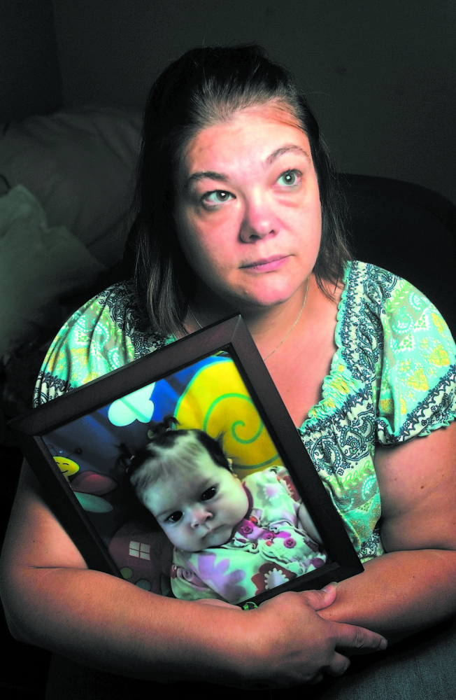 Nicole Greenaway holds a picture of her daughter Brooklyn Foss-Greenaway at her home in Clinton. Her 3-month-old baby died while in the care of a friend July 8, 2012.