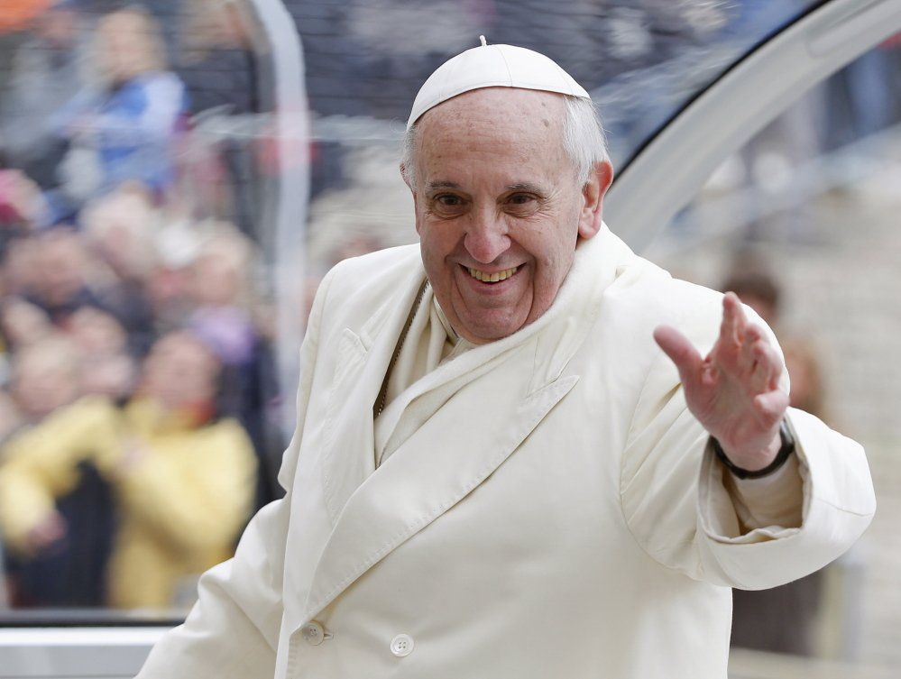 Pope Francis waves as he leaves at the end of his general audience in St. Peter's Square at the Vatican on Wednesday.