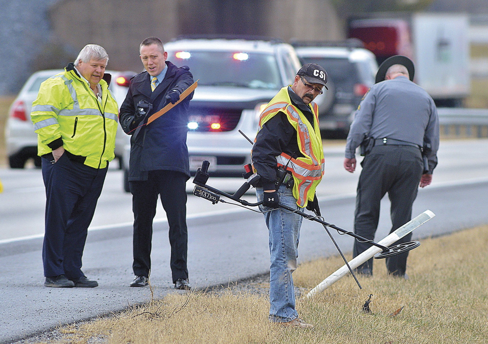Franklin County coroner's office and Pennsylvania State Police staffers search on Jan. 15 for evidence in the fatal shooting of Timothy Davison of Maine along Interstate 81. The shooting occurred there Jan. 4.