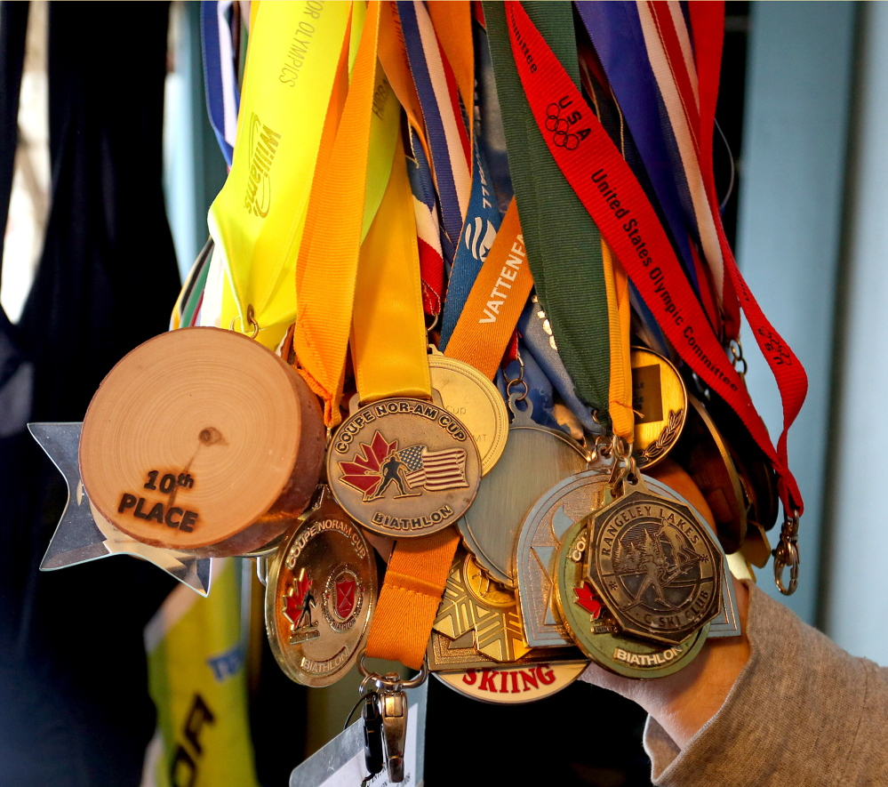 Medals that Russell Currier has won through his years competing as a biathlete.