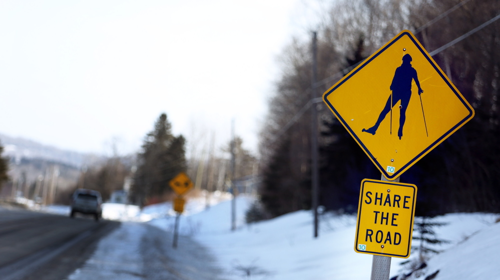 A sign alerts motorists to the likelihood of roller skiers along a road in Presque Isle, where the Maine Winter Sports Center has a world-class training facility. Such signs are commonplace in Aroostook County, where Olympian biathlete Russell Currier was raised.