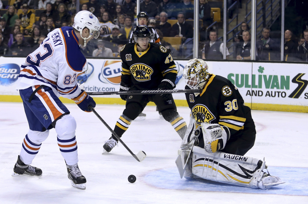 Bruins goalie Chad Johnson makes the save on a shot by Edmonton's Ales Hemsky as Bruins defenseman Torey Krug loses his stick in the first period Saturday.
