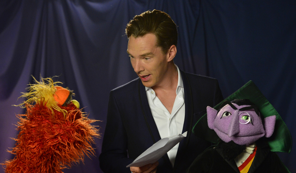 Muppets Murray Monster, left, and Count von Count interact with actor Benedict Cumberbatch for a video.