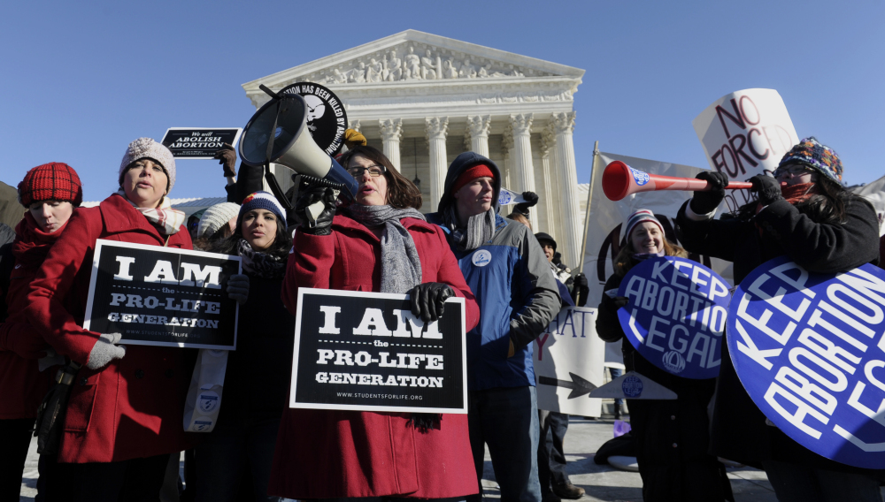 Pro-abortion rights and anti-abortion protesters rally outside the U.S. Supreme Court on Jan. 22, the anniversary of the Roe v. Wade ruling. Between 2008 and 2011, the U.S. saw a decline in the abortion rate, both in states with liberal abortion laws and in states that restrict access to the procedure.
