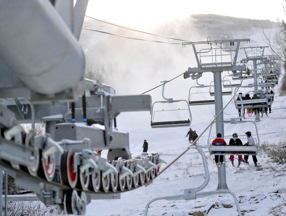 Skiers ride a lift at Sugarloaf. A skier from New York was killed in an accident there Tuesday morning.