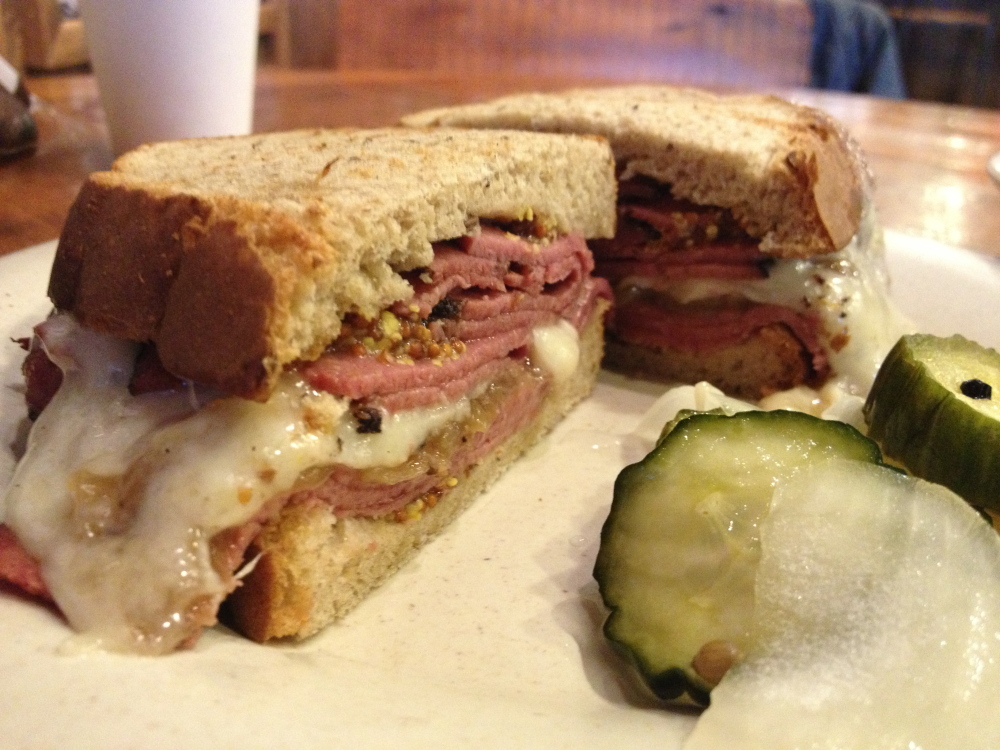 Pineland Farms baby Swiss oozes over all-natural pastrami and caramelized onions in the Black Watch sandwich at 1912 Cafe, located in the L.L. Bean mother ship in Freeport. The accompanying pickles and onions are superb, too.