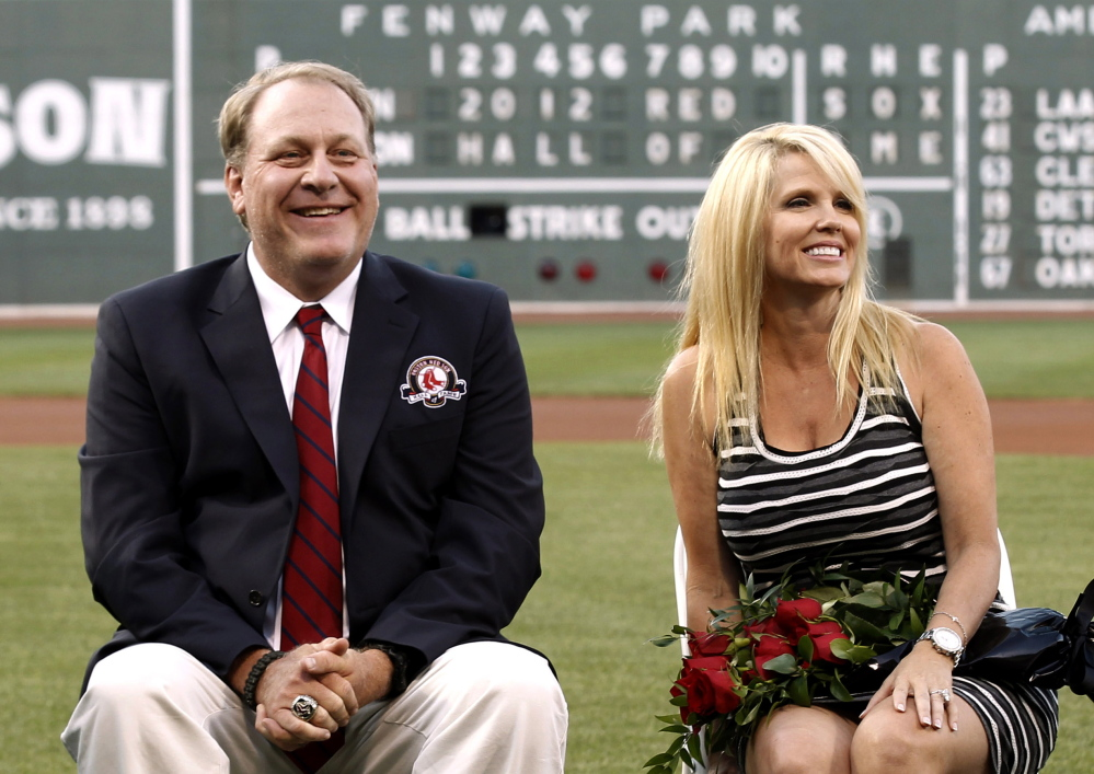 Former Boston Red Sox pitcher Curt Schilling sits with his wife, Shonda, after being introduced as a new member of the Red Sox Hall of Fame in 2012 at Fenway Park in Boston. He has been diagnosed with cancer, he announced Wednesday.