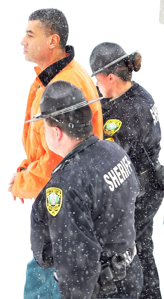 Justin G. Pillsbury walks with Kennebec County deputies out of Kennebec County Superior Court on Wednesday.