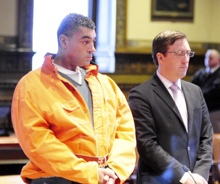 Justin G. Pillsbury, left, and attorney James T. Lawley, stand Wednesday morning in Kennebec County Superior Court in Augusta at a hearing in which he pleaded not guilty to murdering his girlfriend and roommate, Jillian Jones, in their Augusta apartment last November.