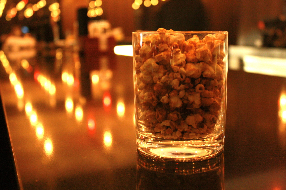 Every table is served a tumbler of the kitchen's house-made duck confit popcorn.