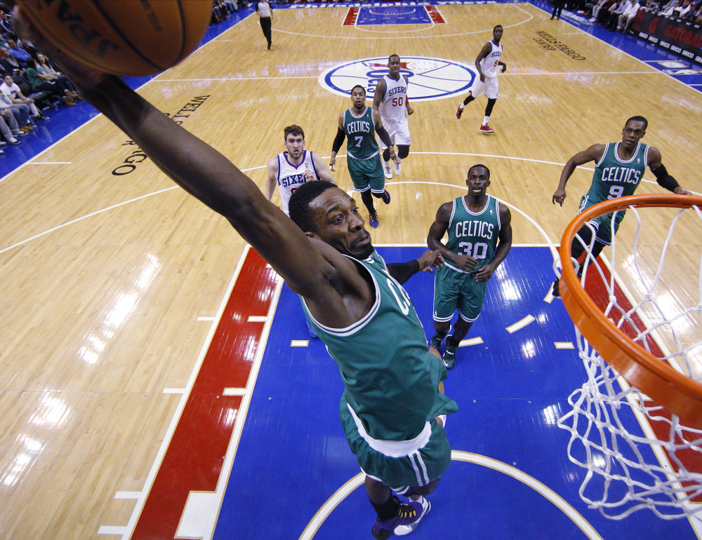 Jeff Green of the Boston Celtics goes for the dunk during the first half against the Philadelphia 76ers' on Wednesday in Philadelphia.