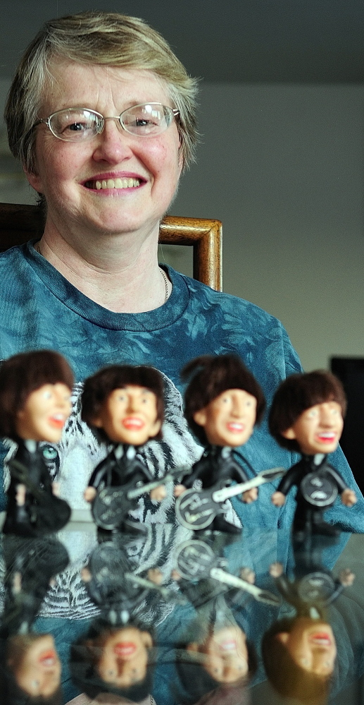 Cindy Masiero of China still has the set of Beatles dolls she got as a child.