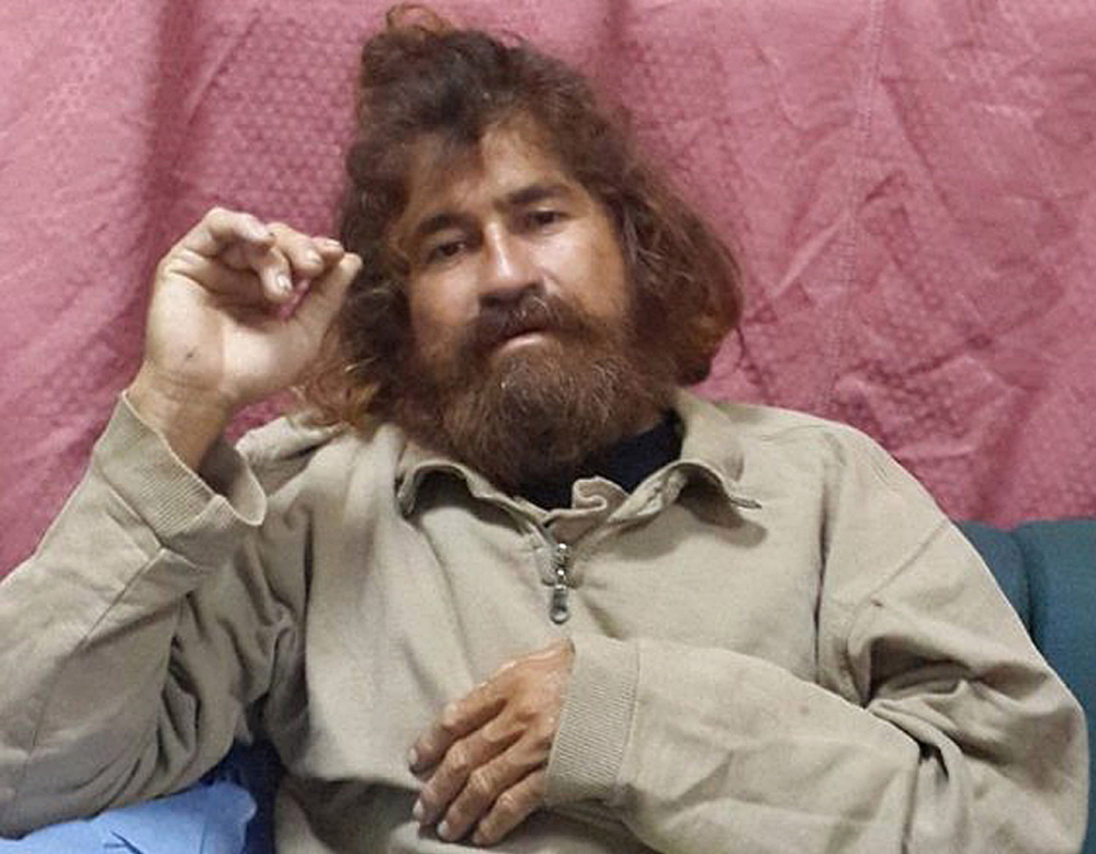 In this photo provided by the Marshall Islands Foreign Affairs Department, 37-year-old Jose Salvador Alvarenga sits on a couch in Majuro in the Marshall Islands, after he was rescued from being washed ashore on the tiny atoll of Ebon in the Pacific Ocean.