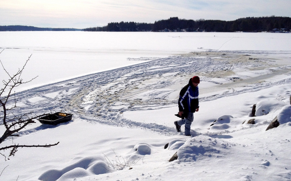 through the ice: The scene where an all-terrain vehicle went through the ice on China Lake on Thursday.