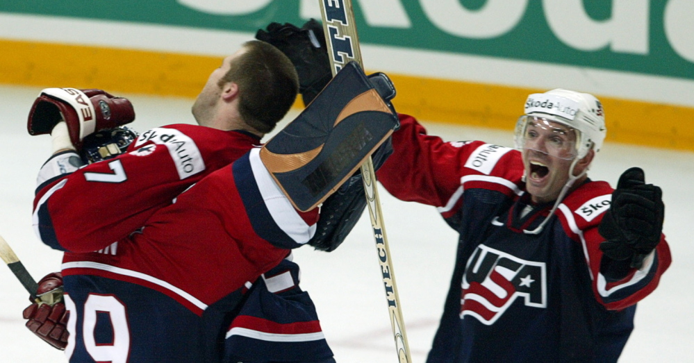 Eric Weinrich, right, who has deep ties to Maine, was the first University of Maine hockey player to make the U.S. Olympic team, in 1988.