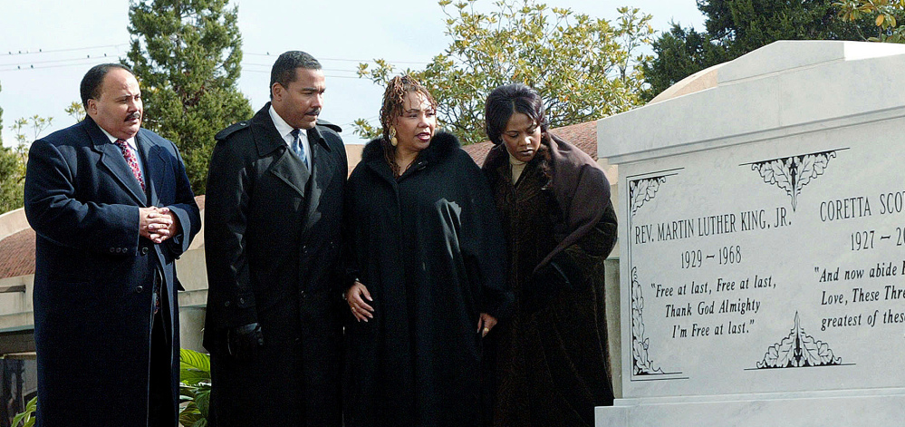 Children of the Rev. Martin Luther King Jr. and Coretta Scott King, from left, Martin Luther King III, Dexter King, Yolanda King (who died in 2007) and Bernice King stand next to a crypt dedicated to their parents in Atlanta.
