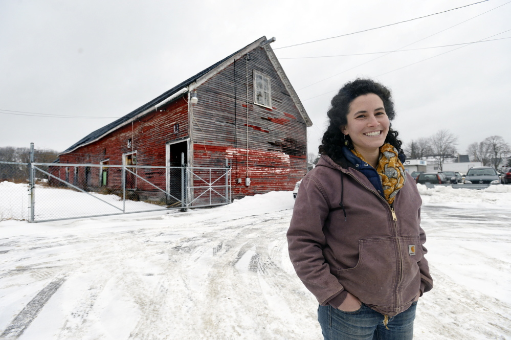 Maina Handmaker in front of the former freight barns in Brunswick where she hopes to see a permanent farmers market. Carrying out her plan will take a lot of work, but it's a proposal that will have notable upsides if it can be realized.