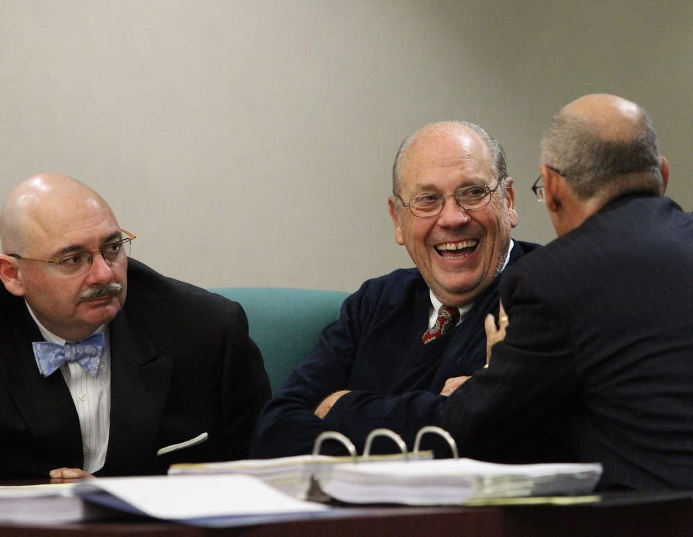 Former Tampa police Capt. Curtis Reeves Jr., center, talks with lawyers Richard Escobar, right, and Dino Michaels.