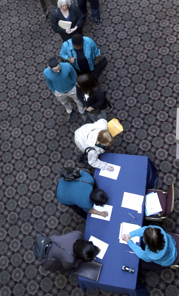 Job seekers line up to meet prospective employers during a career fair at a hotel in Dallas in January.