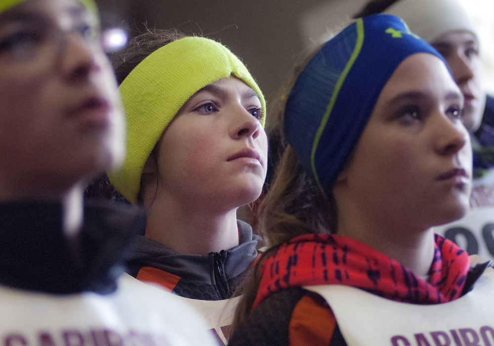 Caribou Middle School ski team members watch intently in Caribou on Saturday as the men's biathlon 10K sprint from Sochi, Russia, is live-streamed.