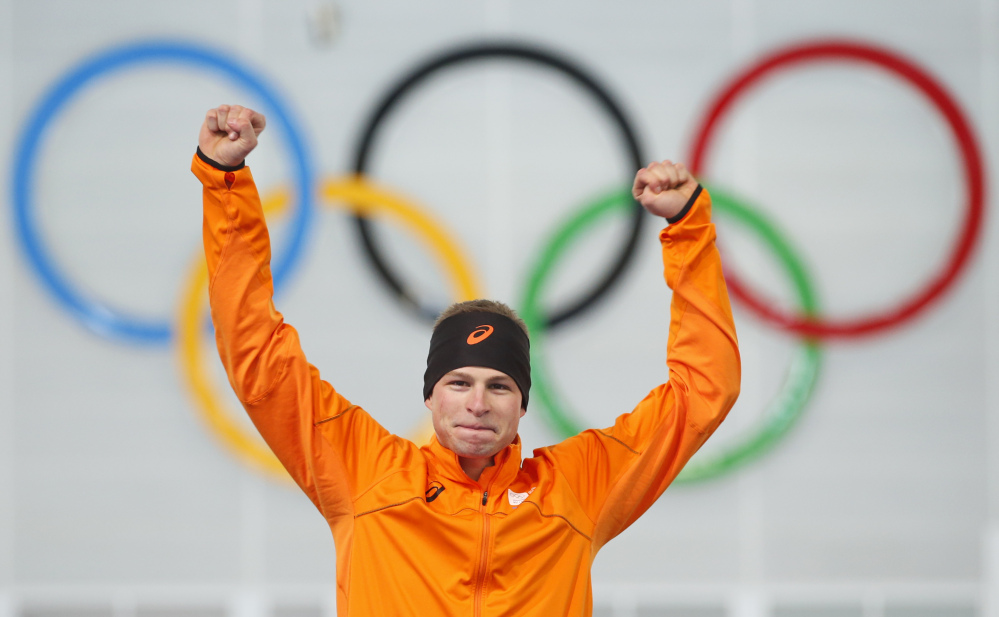 Sven Kramer of the Netherlands celebrates after winning the gold in the men's 5,000-meter speedskating race during the flower ceremony at the Adler Arena Skating Center during the 2014 Winter Olympics in Sochi, Russia, on Saturday.