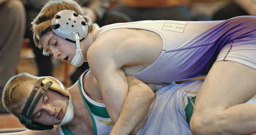 Cody Hughes of Marshwood puts a quick pin on Zachary McGrath of Massabesic.