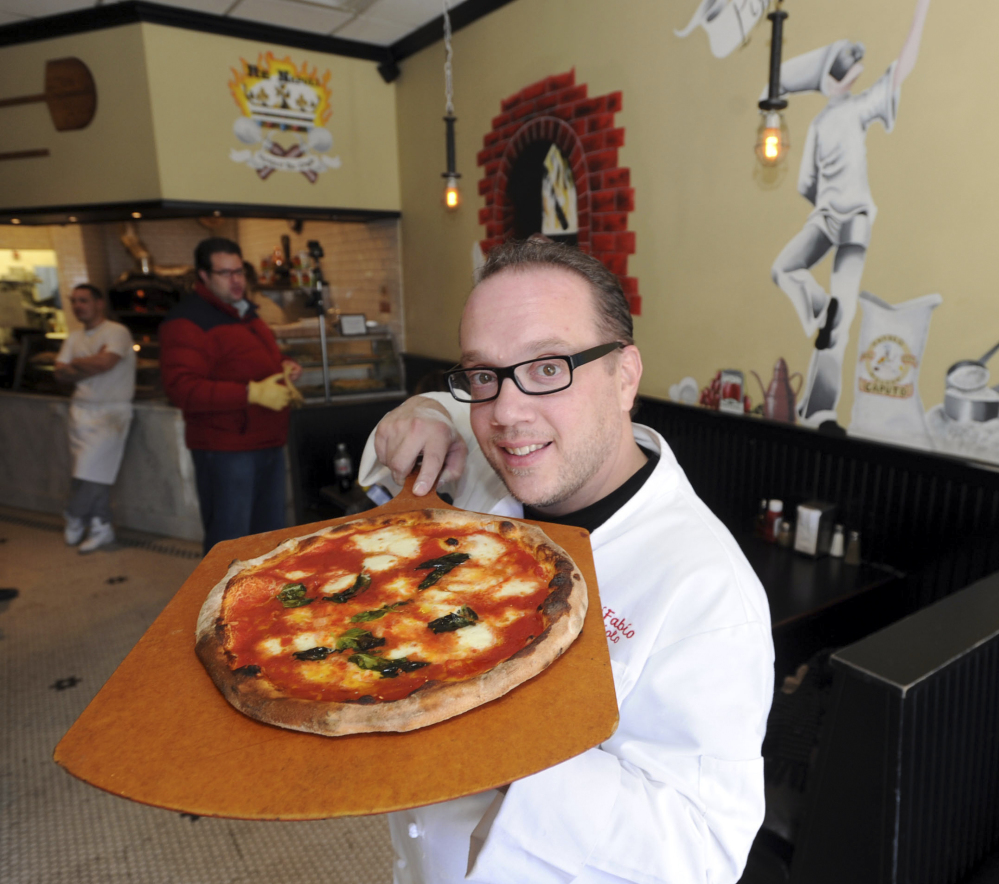 Bruno DiFabio displays a Margherita pizza, prepared in the Napoletana style, at ReNapoli Pizzeria & Chicago Italian Beef in Old Greenwich, Conn. DiFabio has been named as a new judge on Food Network's competitive cooking series,