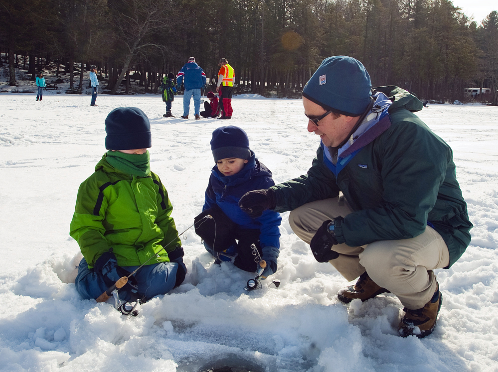 Robert Klee, the new Connecticut Department of Energy and Environmental Protection commissioner, spends time ice fishing with his sons Alexander, 6, and Jacob, 4, during the eighth annual winter festival at Burr Pond in Torrington, Conn., last weekend.