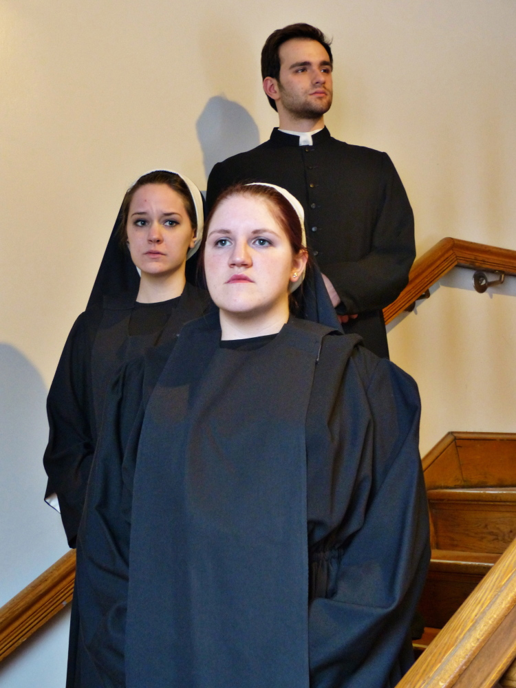 """Ashley Rood, front, as Sister Aloysius, Hannah Perry as Sister James and David Bliss as Father Flynn in the University of Southern Maine Department of Theatre production of """"Doubt,"""" continuing through Feb. 16 at the Studio Theater at Portland Stage."""