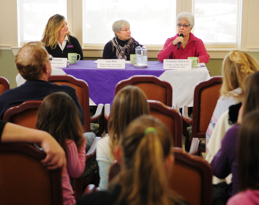 Nancy Provost, left, and Nan Bell, both of the Family Violence Project, and author Francine McEwen participate in a panel discussion about bullying of the elderly during an event Saturday at The Cohen Center in Hallowell.