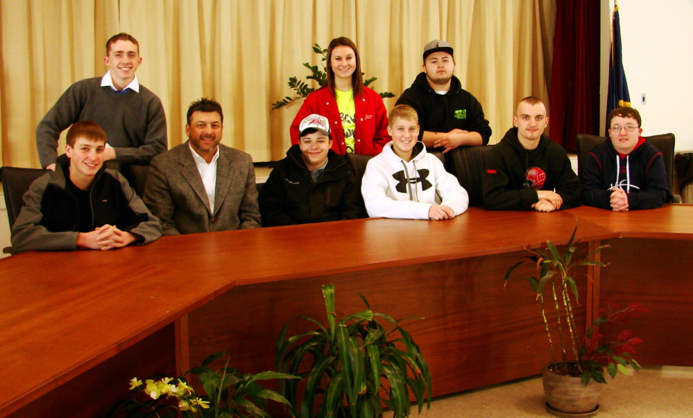 Wells High School students meet with Ogunquit Town Manager Tom Fortier recently to learn about careers in local government. Front row from left, Nicholas Cousins, Fortier, Ryan Shackford, Tyler Bartlett, Chris Carney and Brandon Cox; back row from left, Dan Charpentier, Kasey Bullard and Chris Arsenault.