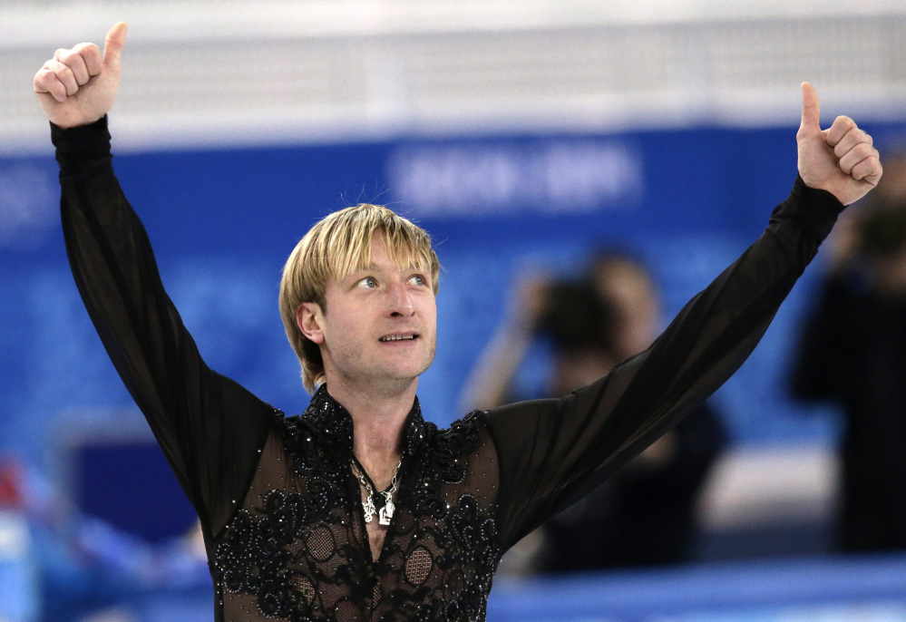 Evgeni Plushenko of Russia gestures after competing in the men's team free skate at the Iceberg Skating Palace in Sochi, Russia. The hosts won gold in the event's Olympic debut.