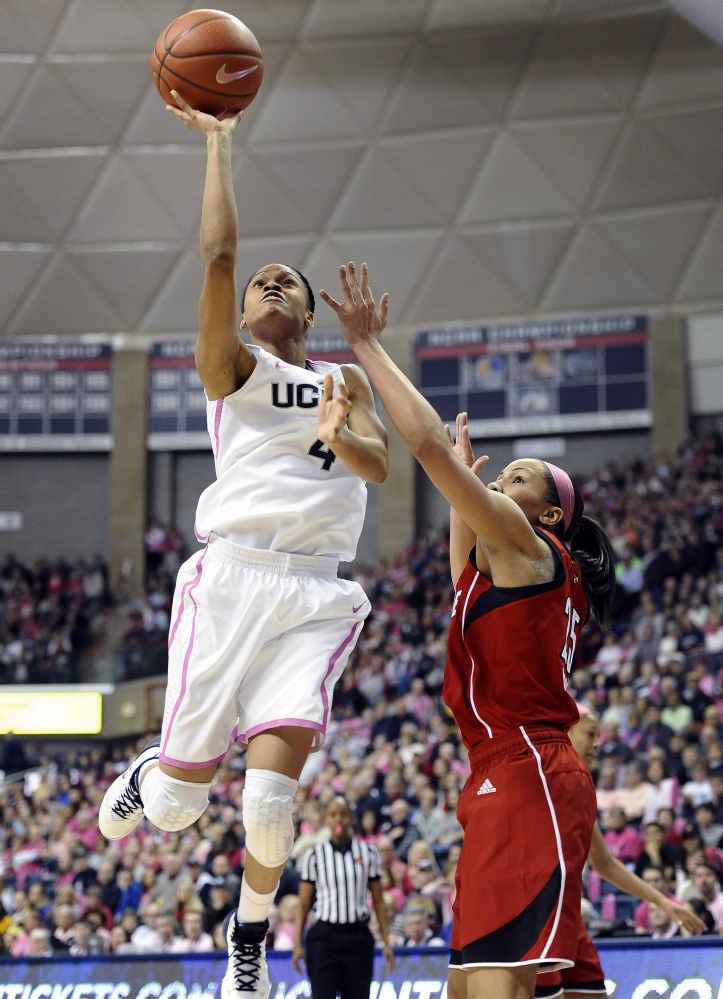 Connecticut's Moriah Jefferson goes up against Louisville's Tia Gibbs during the Huskies' 81-64 win Sunday afternoon at Storrs, Conn. Jefferson had a career high 18 points as Connecticut, defending national champs, won a rematch of last year's NCAA title game.