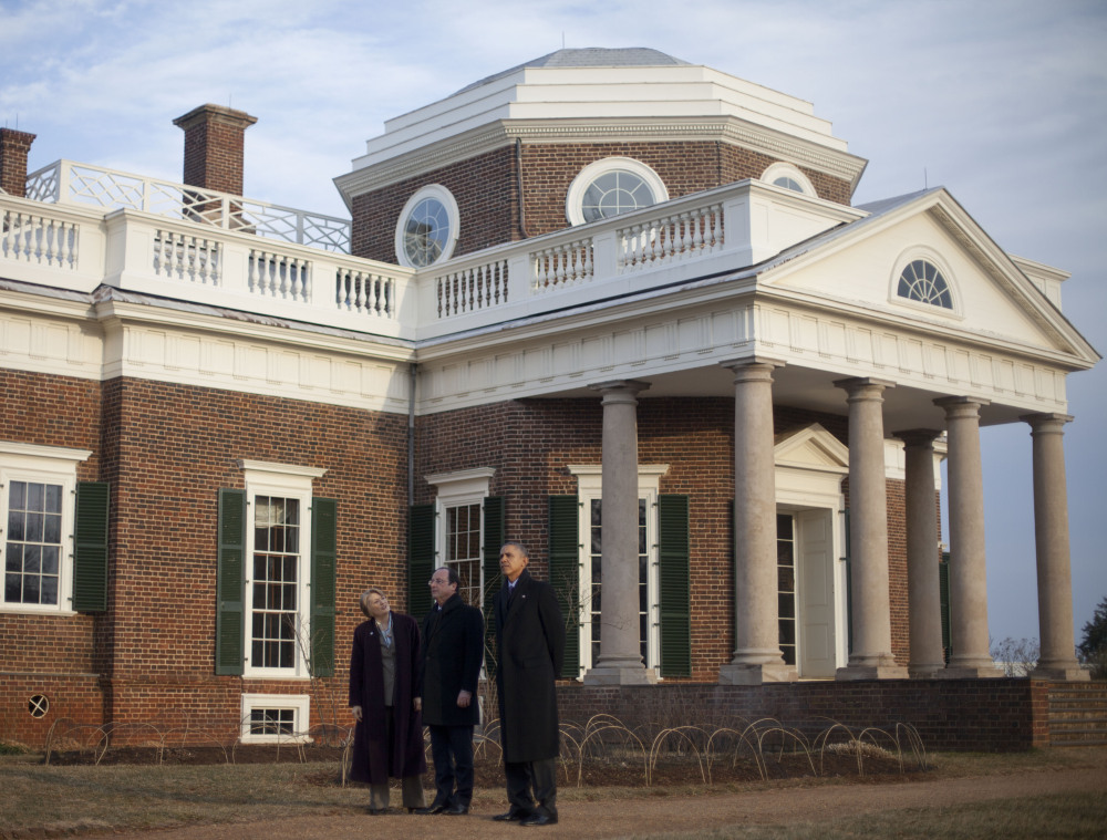 President Barack Obama, right, and French President Francois Hollande, center, tour the grounds of Monticello on Monday. Hollande recently broke up with his longtime partner Valerie Trierweiler in France and is dogged by rumors of an affair with an actress.