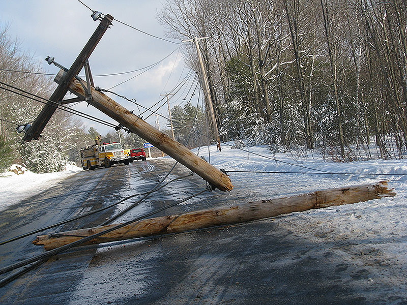 A broken untility pole and dangling wires block Route 1 in Arundel on Monday. A 2005 Chvrolet Trailblazer driven by Shirley Sargent of Kennebunk struck the pole, snapping it in half.