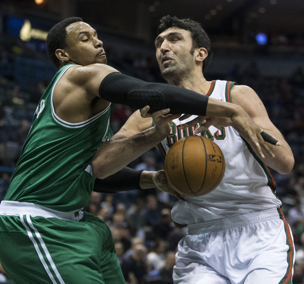 Boston's Jared Sullinger, left, strips the ball from Milwaukee's Zaza Pachulia during the second half of Monday night's game in Milwaukee, won by the Celtics.
