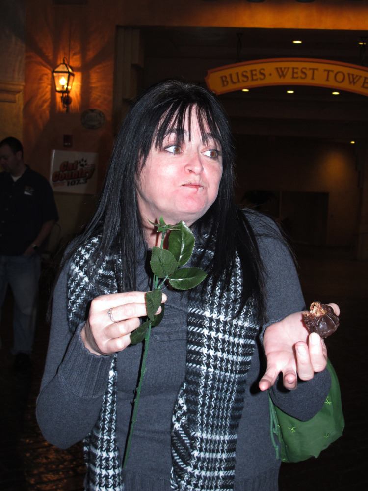 An unexpected wave of saltiness hits Melissa Ehrke of Egg Harbor Township, N.J., as she tries chocolate-covered bacon strips shaped like a rose at the Tropicana Casino and Resort in Atlantic City, N.J. on Monday.